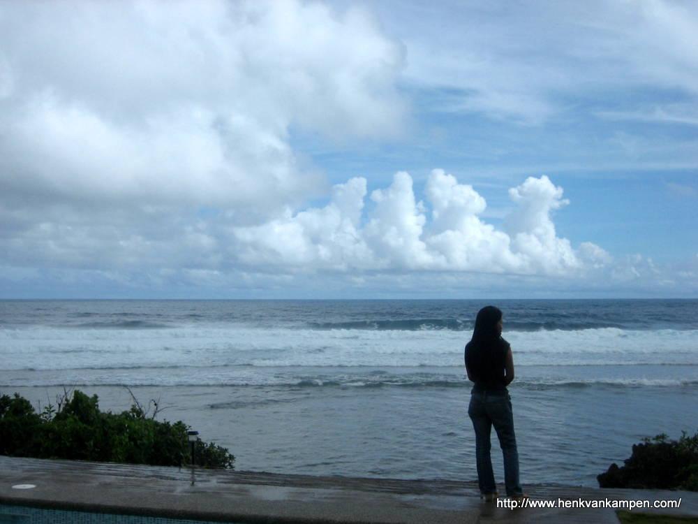 Girl overlooking the ocean