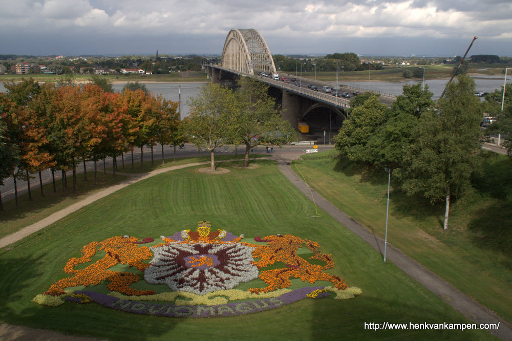View of the bridge over the river Waal in Nijmegen, with a flower mosaic in the foreground
