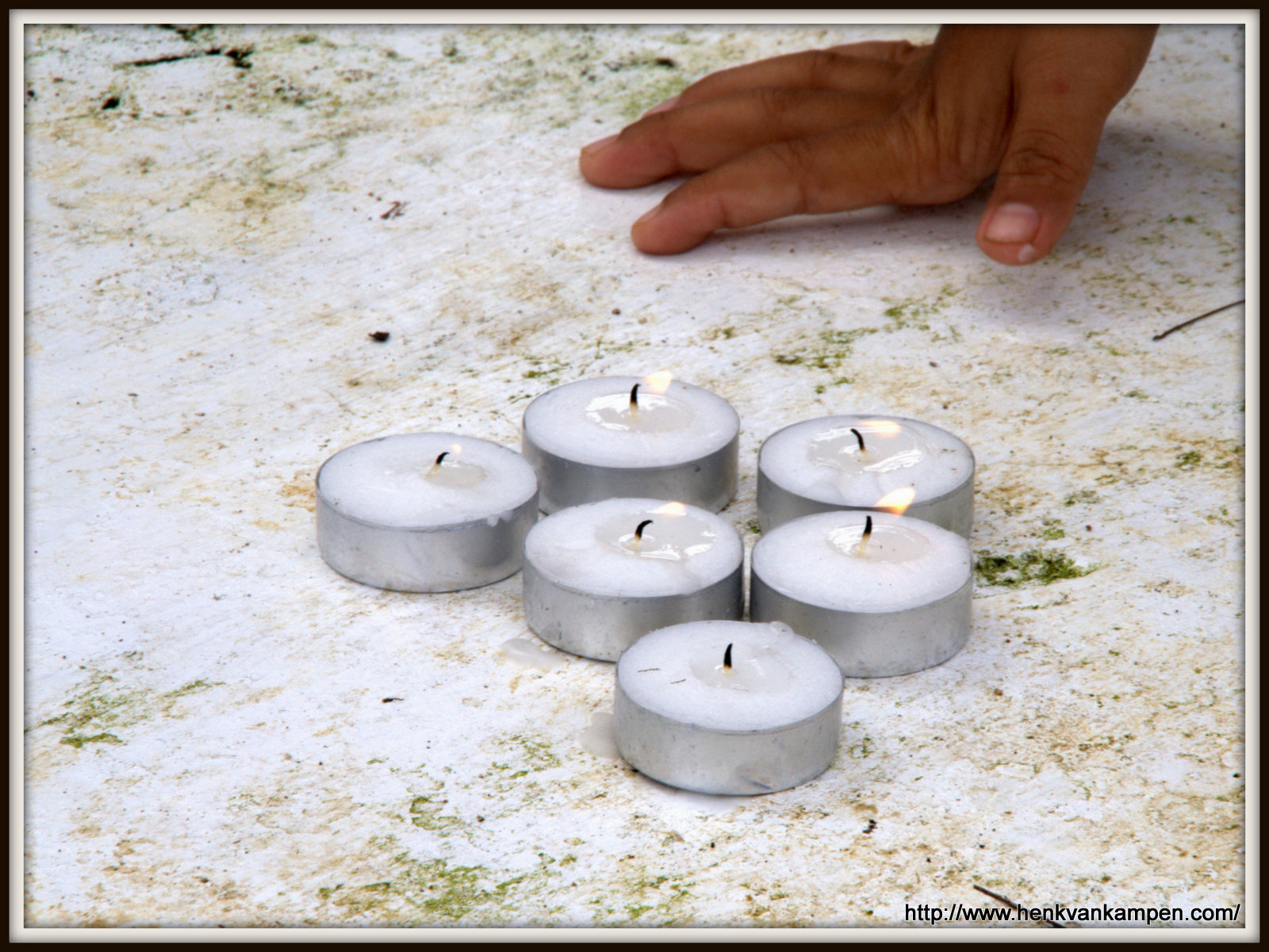 Candles at the tomb of Haneper Duroy (1939-2010)