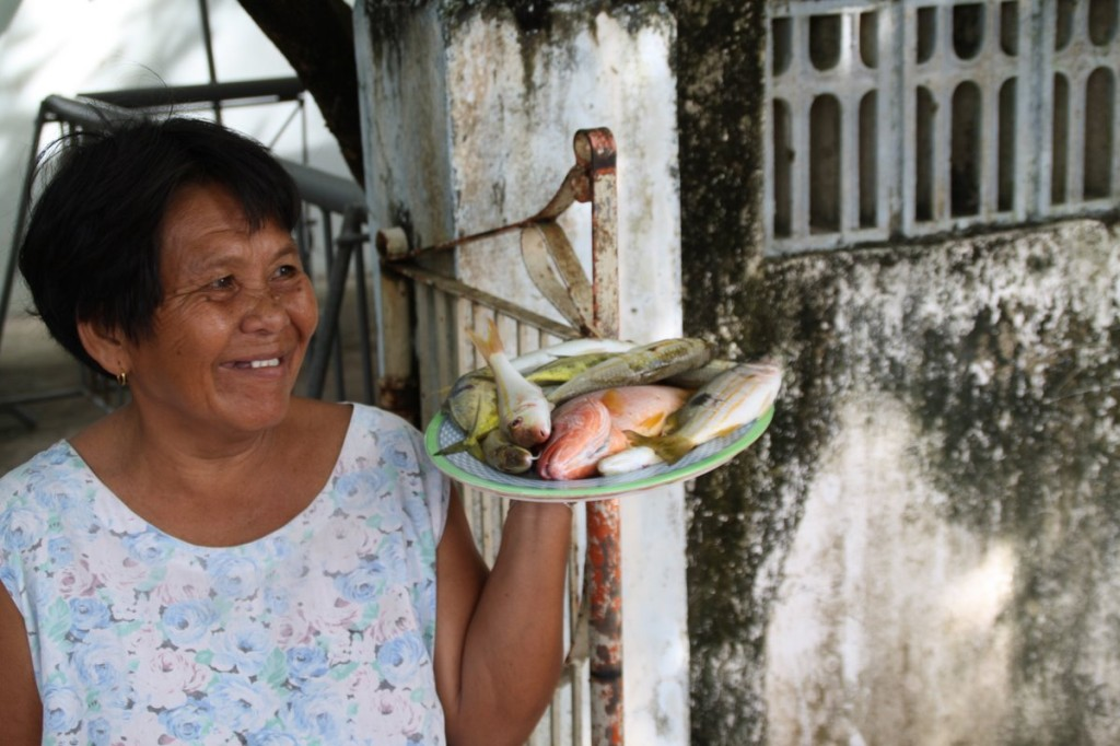 Lady selling catch of the day